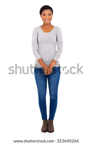 happy young african woman standing on white background - stock photo