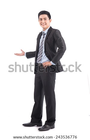 Happy young asian businessman presenting isolated over white background - stock photo
