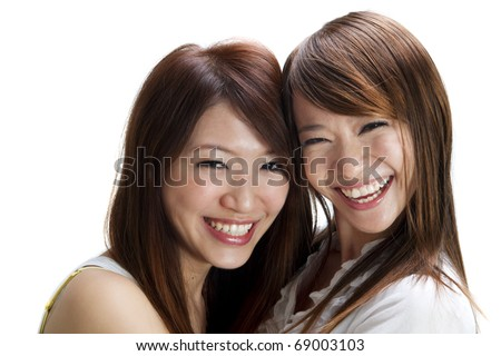 Happy young Asian female having fun together. - stock photo