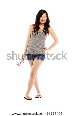 Happy young asian female holding sun glasses against white background