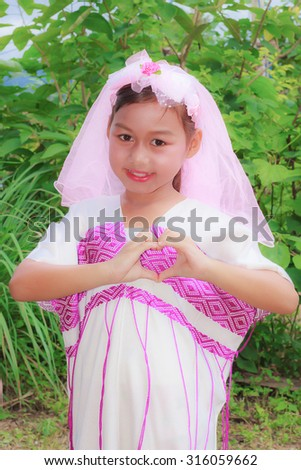 Happy young Asian girl showing heart shape sign or love sign,Portrait of beautiful Asian girl,Thai girl,Positive emotion facial expression, Fashion young Karen girl.  - stock photo