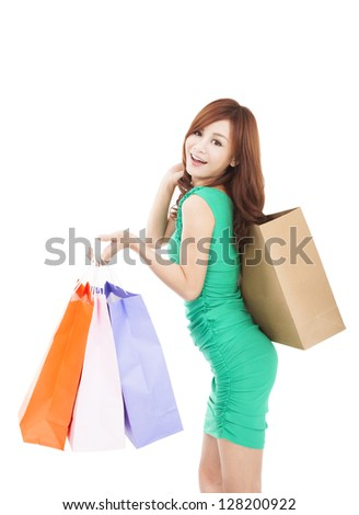 happy young asian woman holding shopping bag - stock photo