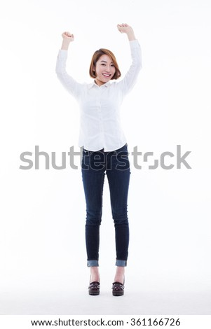Happy young Asian woman stretching her arms.