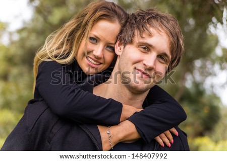 Happy young attractive couple portrait, smiling in outdoor environment - stock photo