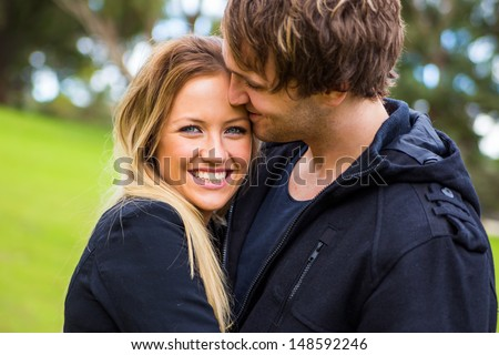 Happy young attractive smiling couple enjoy their time outdoor - stock photo