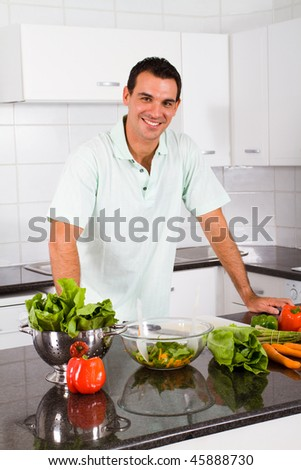 happy young bachelor in kitchen