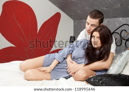 happy young beautiful couple in bed at home