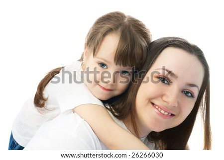 happy young beautiful mother giving her daughter piggyback ride - stock photo