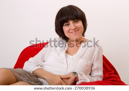 happy young beautiful woman relaxing on sofa at home - stock photo