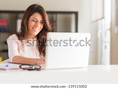 Happy Young Beautiful Woman Using Laptop, Indoors - stock photo