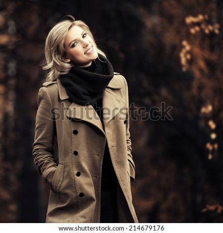 Happy young blond fashion woman in autumn forest  - stock photo