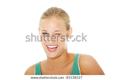 Happy young blond woman blinking. Isolated on white background. - stock photo