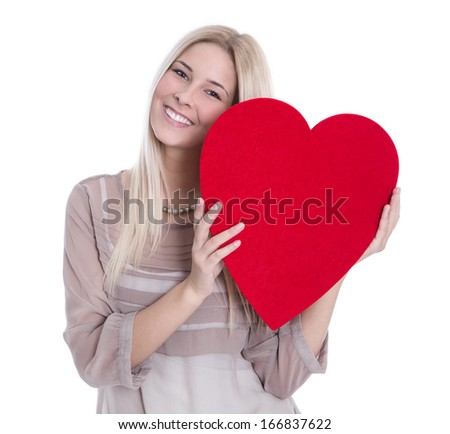 Happy young blonde Caucasian woman holding red heart.