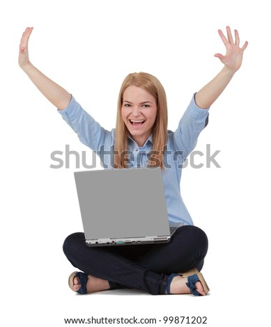 Happy young blonde woman raising hands while sitting with a laptop in her lap.