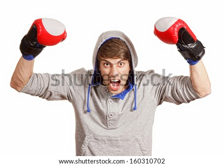 Happy young boxer keeping his arms raised like a winner, isolated on white background