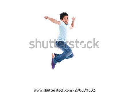 Happy Young boy jumping isolated over white background