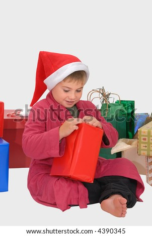 Happy young boy opening a present on Christmas morning, isolated