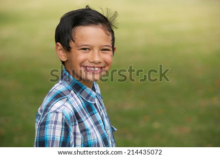 Happy young boy outdoors. - stock photo