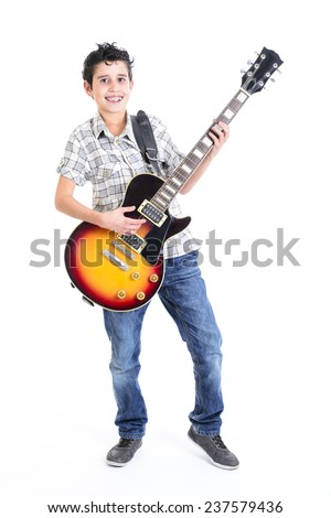 Happy young boy playing guitar   - stock photo