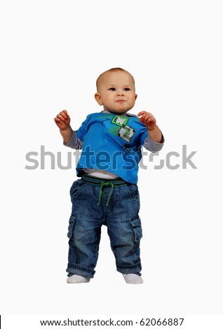 happy young boy taking his first step - stock photo