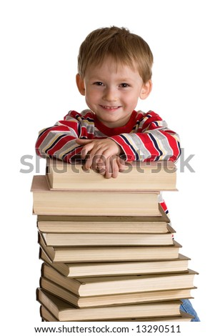Happy young boy with books - stock photo
