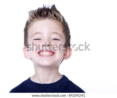 Happy young boy with smile on his face on white - stock photo