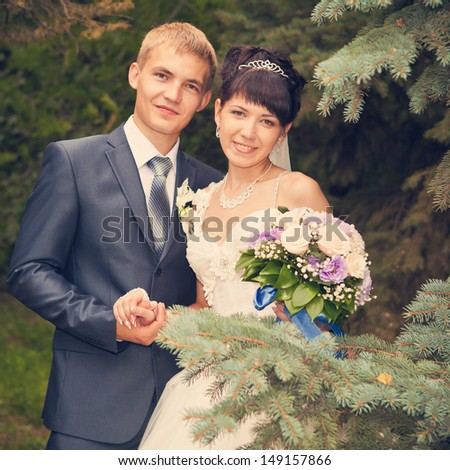 Happy young bride and groom on their wedding day