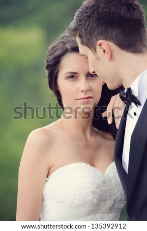Happy young bride and groom smiling on their wedding day - stock photo