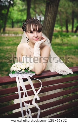 Happy young bride on her wedding day. Wedding couple - new family! wedding dress. Bridal wedding bouquet of flowers - stock photo