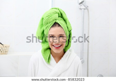 Happy young brunette after bath or shower - stock photo