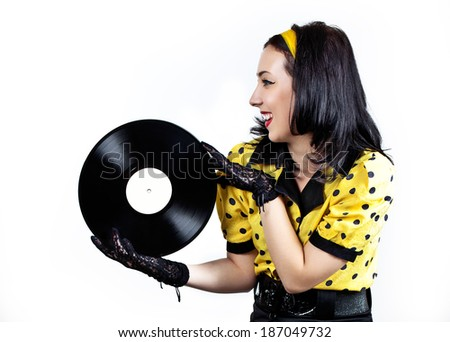 Happy young brunette in retro style with a vinyl record - stock photo