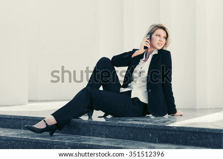 Happy young business woman calling on cell phone  - stock photo