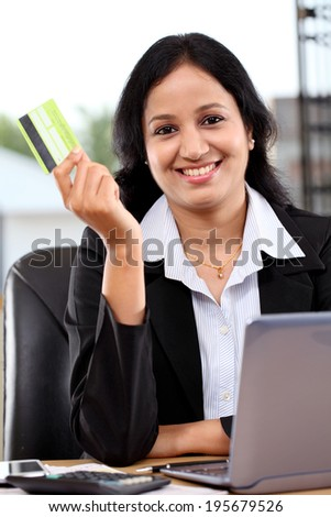 Happy young business woman doing online shopping - stock photo