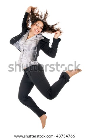 happy young business woman holding hairs and jumping over white background