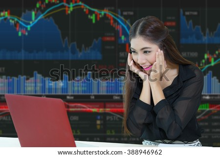 Happy young business woman looking at laptop screen and surprised