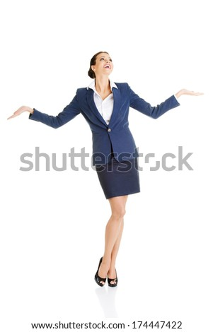 Happy young business woman showing copy space on her palm, isolated on white  - stock photo