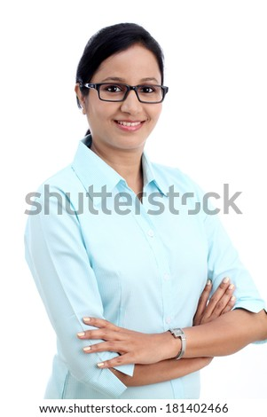 Happy young business woman with arms crossed against white  - stock photo