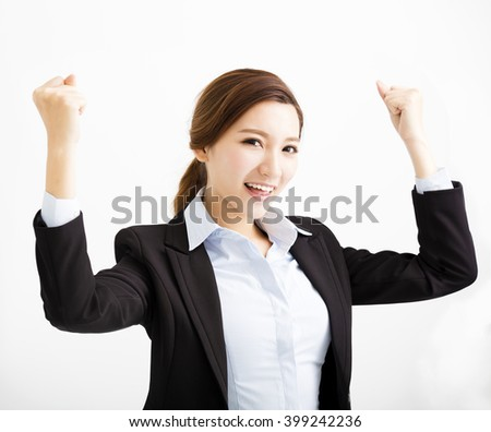 happy young business woman with success gesture - stock photo