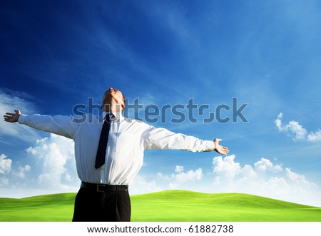 happy young businessman and sunset - stock photo