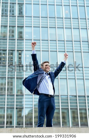 Happy young businessman celebrating his success - stock photo