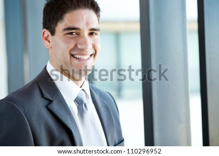 happy young businessman closeup portrait - stock photo