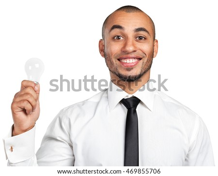 Happy Young Businessman Holding Light Bulb