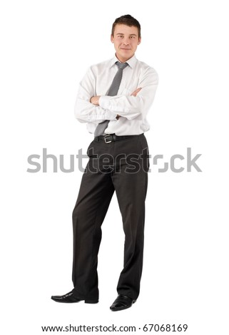 Happy young businessman with crossed arms over white background - stock photo