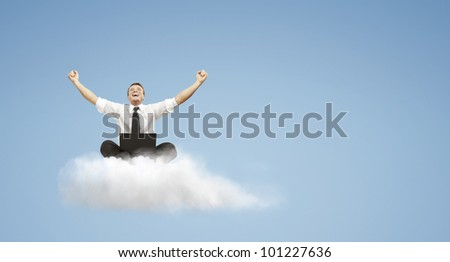 Happy young businessman with laptop sitting on the cloud. - stock photo
