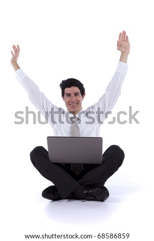 Happy young businessman working with his wireless laptop (isolated on white) - stock photo
