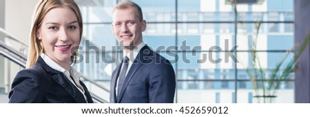 Happy young businesspeople in office after successful business meeting - stock photo