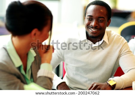 Happy young businesspeople working at office - stock photo