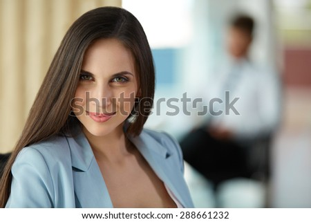 Happy Young Businesswoman at Office
