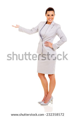 happy young businesswoman doing welcome gesture on white background - stock photo