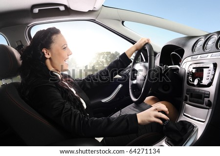 happy young businesswoman drive modern comfortable car - stock photo